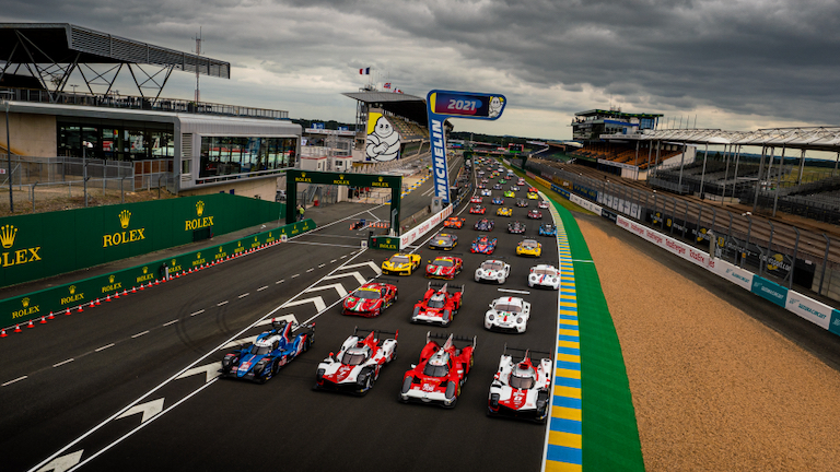 The field for the 2021 24 Hours of Le Mans lined up on the grid for the pre-race photoshoot