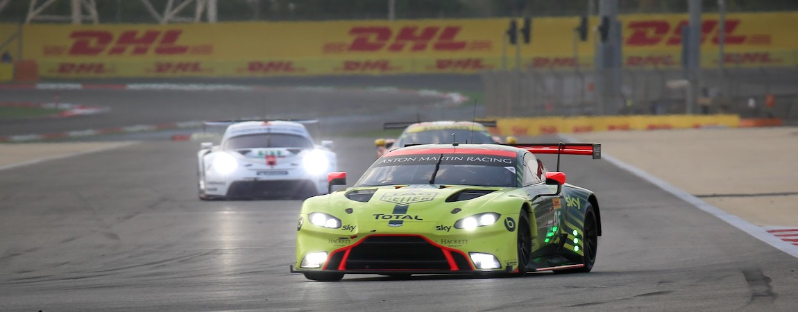 The LMGTE cars of Aston Martin and Porsche at a race